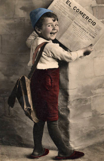 Little boy holding a newspaper