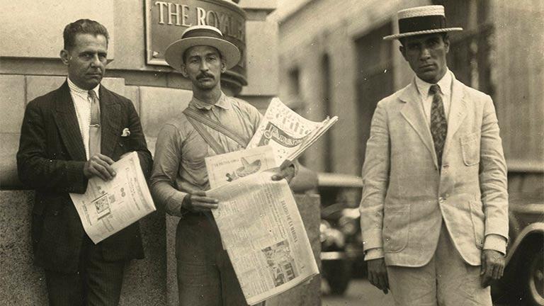 Newspaper vendor selling Diario de la Marina in Havana